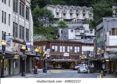 JUNEAU, ALASKA/USA - JULY 16, 2016: View of intersection, storefronts, and buildings on nearby mountainside in downtown Juneau, early morning in July.