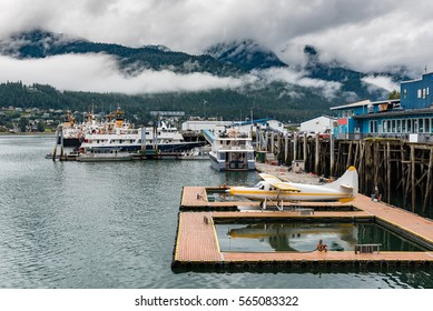 Juneau harbor with sea plane and boats on a cloudy summer day