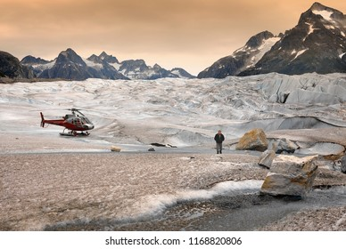 Juneau. USA. 07.23.04. Tourist helicopter landing on the Mendenhall Glacier in the Juneau Ice fields in Alaska