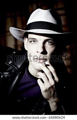 Junger Mann Mit Zigarette Und Hut Stock Photo Edit Now 66880624