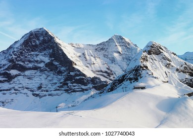 Jungfrau, Eiger and Monch Mountain peaks in winter Swiss Alps, from helicopter view