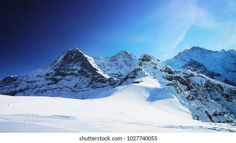 Jungfrau, Eiger, Monch Mountain peaks, winter Swiss Alps, a helicopter view