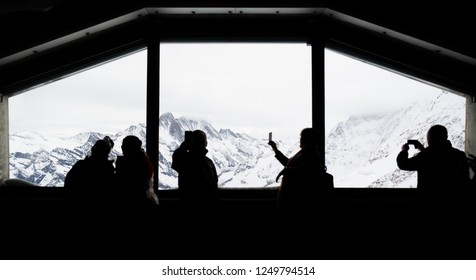 Jungfrau, Switzerland - May 2, 2018 : Tourists is taking a photo of Jungfrau from view point. Jungfrau is one of the most beautiful mountain in Europe