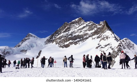 Jungfrau switzerland-16 May 2019: A lot of Tourists on Jungfrau mountain in Switzerland on snow background, winter time. Mountain background,