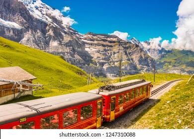The Jungfraubahn train transporting tourists to Jungfraujoch railway station, highest railway station in Europe, from Kleine Scheidegg and Grindelwald