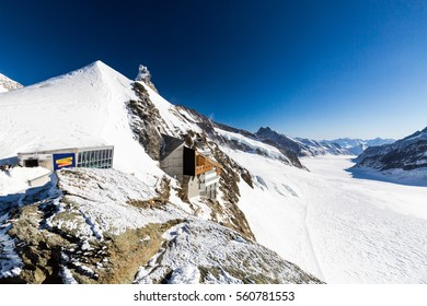 JUNGFRAUJOCH, SWITZERLAND - JANUARY 6, 2017: View to the Jungfraujoch observation station and Aletsch Glacier on January 6, 2017. Its the highest elevated point to reach by a cog railway in Europe.