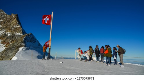 Jungfraujoch, Switzerland - Oct 20, 2018. Beautiful snow Alps Mountain with tourists at Jungfraujoch Station, Switzerland.