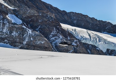 Jungfraujoch, Switzerland - Oct 20, 2018. Tourist helicopter landing on the glacier of Jungfraujoch, Switzerland.