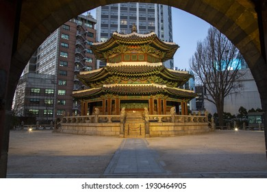 Jung-gu, Seoul, South Korea - December 18, 2020: Night view of Hwangudan Altar with the background of high rise buildings