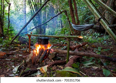 Jungle barbecue with open fire in the middle of a asian bamboo forrest