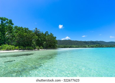 Jungle and deserted tropical beach with clear turquoise water and blue sky, Ishigaki Island of the Yaeyama Islands, Okinawa, Japan