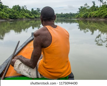 Jungle, Indonesia - January 13, 2015: The locals  pulling the boat out of the water to the shore of the river