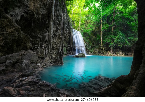 Jungle landscape with flowing turquoise water of Erawan cascade waterfall at deep tropical rain forest. National Park Kanchanaburi, Thailand