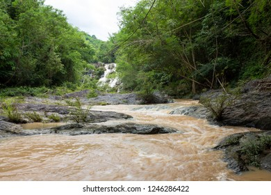 Jungle landscape. Than Thip waterfall on cloudy sky at Phetchabun, Thailand