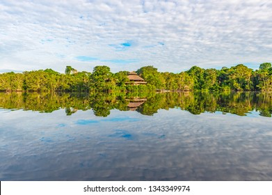 Jungle lodge located in the Amazon Rainforest by a lagoon. The tributaries of the Amazon river traverse the countries of Guyana, Ecuador, Peru, Brazil, Colombia, Venezuela, Suriname and Bolivia.