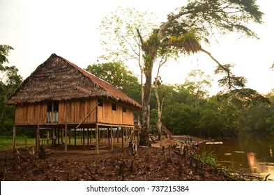 A jungle lodge at sunset in the Pacaya Samiria National Reserve, Peru