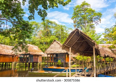 Jungle shacks on stilts in the Amazon rain forest near Iquitos, Peru