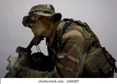 jungle soldier in the army dressed in camo side view