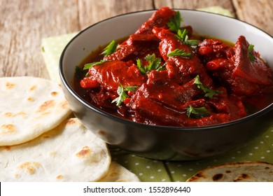 Jungli Laal Maas -A famous dish from Rajasthan - fiery hot mutton dish close-up on the table. horizontal