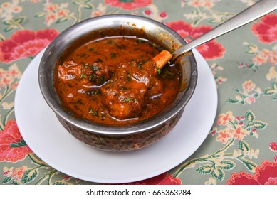 Jungli Laal Maas spicy hot lamb meat curry from Jaipur Rajasthan, India. It is a red mutton Rogan josh curry prepared in a sauce of curd and hot spices red chillies. Ramzan special Kerala Indian