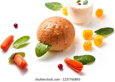 Junior bun with fruit and mint leaves on the white background