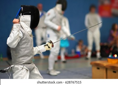 Junior Girl at foil fencing tournament