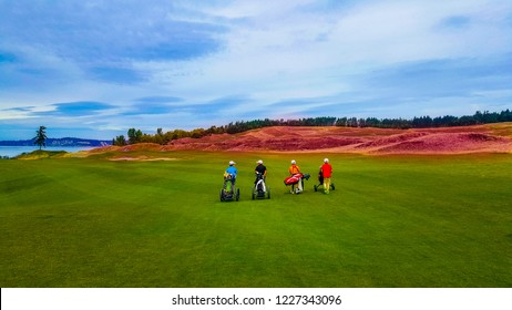 Junior Golfers Pulling Golf Carts on Fairway - Chambers Bay, Washington, USA, September 15 2016