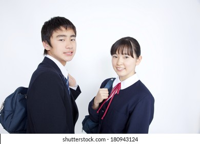 Junior high Japanese man and Japanese woman who look back
