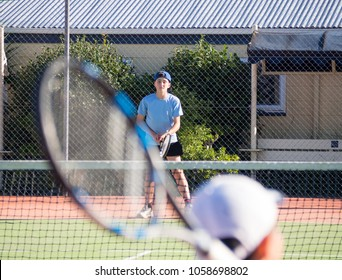 Junior Teen Child Waiting to Receive Serve on Tennis Court During Tennis Match Changing Depth of Field