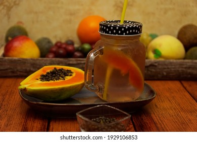 Juniper berry syrup lemonade with papaya and lime.colorful lemonade arranged in glasses
