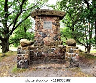 In the juniper grove in Tietlingen near Fallingbostel in the Lüneburger Heide stands a monument in memory of the German local poet Hermann Löns. Germany, Fallingbostel 05/31/2018