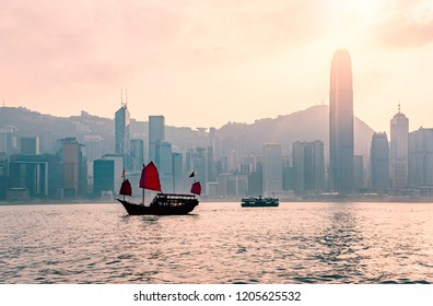 Junk boat in Hong Kong at Victoria harbour in the evening : The famous place in Hong Kong , China