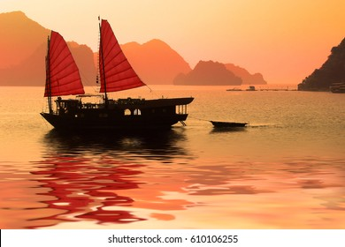 Junk boat at sunset in Halong Bay, Vietnam