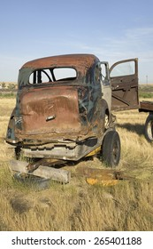 Junk car in field near South Dakota and Nebraska border