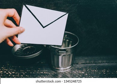 junk email envelope going in the trash, concept of getting rid of spam