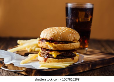 junk food with burger and french fries on wooden table background