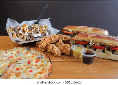 Junk food fiesta, Pizza, sandwiches, chicken strips, poutine