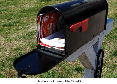 junk mail in open US residential mailbox
