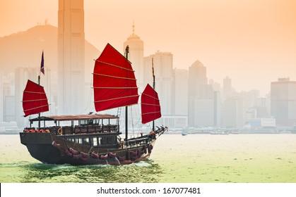 Junk Ship sails in Victoria Harbor in Hong Kong, China.