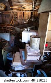 Junk storage or garage room, vertical image