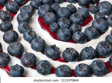 junket with big blueberries and red cherry jam, spiral decoration