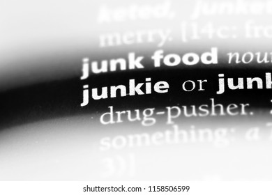 junkie word in a dictionary. junkie concept.