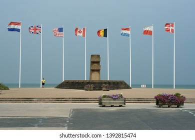 Juno-beach, Normandy/France - September 9th, 2014: War memorial with monument and flags at Juno beach in Normandy, France