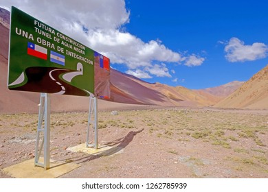 JUNTAS DEL TORO, CHILE, MARCH 14, 2018: Road sign showing the Agua Negra Tunnel project through the Agua Negra Mountain Pass from the Elqui Valley, Chile to Argentina, South America, on March 14, 2018