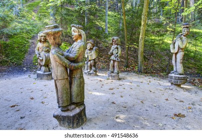 JUODKRANTE, LITHUANIA - 18 SEPTEMBER 2016: Old wooden sculptures in the forest. Witch Hill park, Lithuania.
