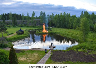 Juokslahti, Finland - June 23 2018: The traditional midsummer bonfire was lit a day later at the center of a small beach in Majatalo Morva because of the bad weather on the eve of midsummer.