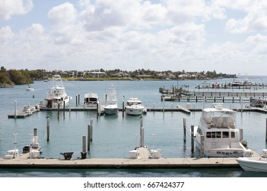 Jupiter, FL, USA - March 30, 2017: Loxahatchee River boats docked in a marina on a mostly sunny day. Many boats parked in docks on the Loxahatchee River.