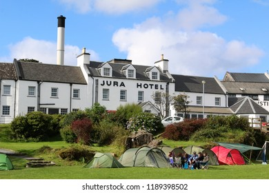 The Jura Hotel with distillery chimney behind - taken from the beach camping field during the Jura Music Festival : Craighouse, Isle Of Jura, Scotland, UK : 22 September 2018 : Pic Mick Atkins