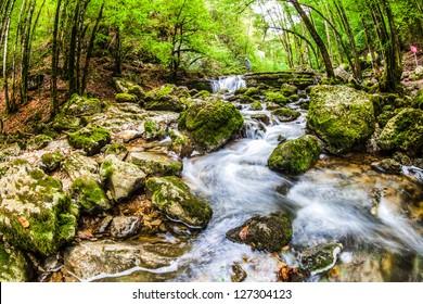 Jura mountain range river landscape, France.