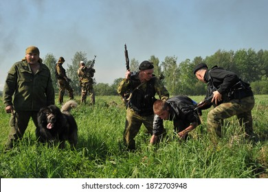 """JURGA, SIBERIA, RUSSIA - JUNE 7,2011:Hostages taken prisoner. Courses for war correspondents """"Bastion"""", rules of conduct in captivity"""